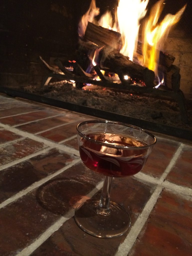 Manhattan by a cozy wood fire